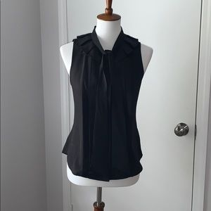 S black sleeveless button up blouse